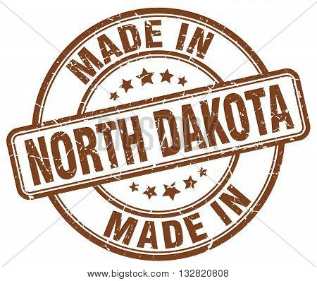 made in North Dakota brown round vintage stamp.North Dakota stamp.North Dakota seal.North Dakota tag.North Dakota.North Dakota sign.North.Dakota.North Dakota label.stamp.made.in.made in.