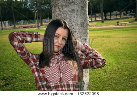 the young nice beautiful girl was photographed in park on walk