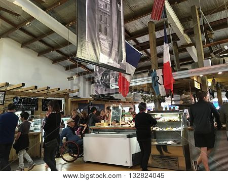 AUCKLANDJUNE 4: Food lovers gather to buy and taste top quality products from both New Zealand artisan producers and growers and from overseas at the La Cigale French Market in Auckland New Zealand on June 4 2016.