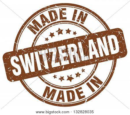 made in Switzerland brown round vintage stamp.Switzerland stamp.Switzerland seal.Switzerland tag.Switzerland.Switzerland sign.Switzerland.Switzerland label.stamp.made.in.made in.