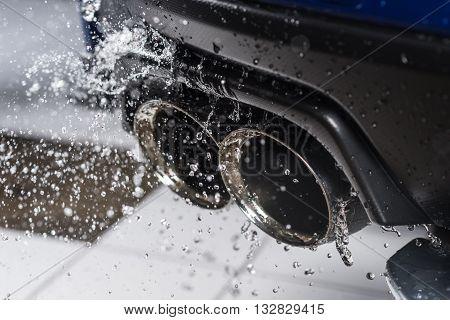Car detailing series : Water splashing on car muffler