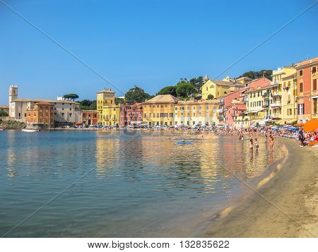 Sestri Levante, Liguria, Italy - circa June 2010: the spectacular beach of the Bay of Silence with colorful houses reflected in the sea. Famous Italian seaside resort.