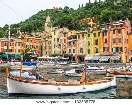 Portofino, Liguria, Italy - circa June 2010: panorama of picturesque harbor and luxurious yachts of Portofino, in the famous vacation resort and italian fishing village, Genoa province , Italy.