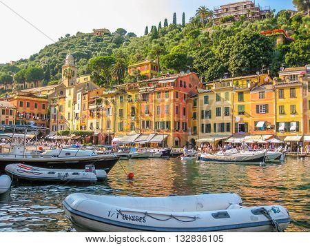 Portofino, Liguria, Italy - circa June 2010: panorama of picturesque harbor and luxurious yachts of Portofino, in the famous vacation resort and italian fishing village, Genoa provinces, Italy.