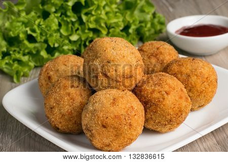 Sri Lankan style fish cutlets with sauce