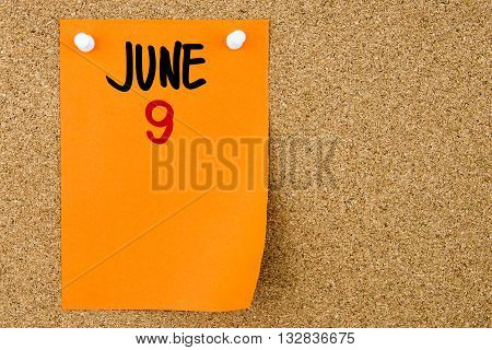 9 June Written On Orange Paper Note