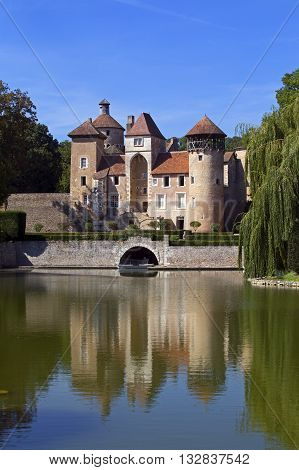 French medieval castle with reflection on the lake