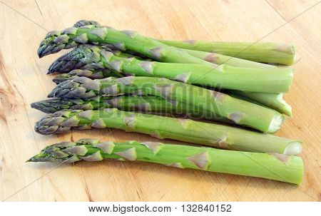 Fresh asparagus on cutting board in horizontal format