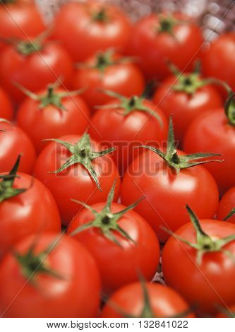 LOTS OF FRESH CHERRY TOMATOES , VERTICAL PHOTO