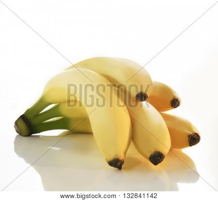 BANANA BUNCH WITH FIVE BANANAS , ISOLATED ON WHITE BACKGROUND WITH REFLECTION