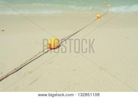 Yellow Buoy On The Beach