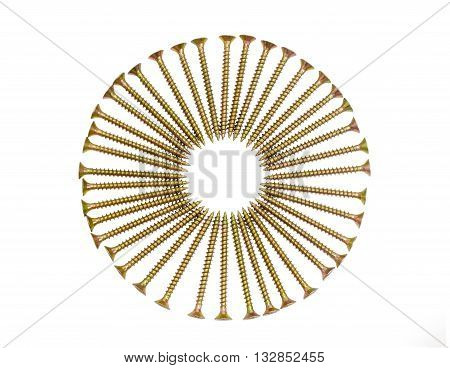Zinc plated chipboard screws with countersunk heads stacked in a circle closeup on a light background