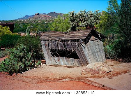 Old weather beaten wooden shack in the desert