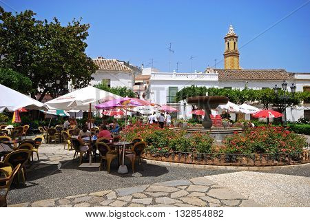 ESTEPONA, SPAIN - JULY 18, 2008 - Fountain and pavement cafes in the Plaza las flores Estepona Malaga Province Andalucia Spain Western Europe, July 18, 2008.