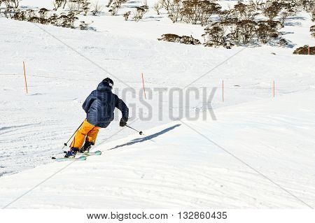 Skier racing through a Ski Cross Course - racing against the clock in the Australia Alps