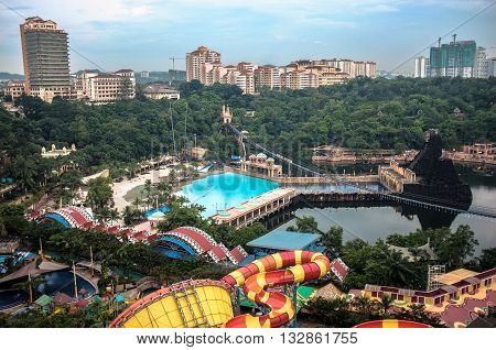 KUALA LUMPUR, MALAYSIA - FEBRUARY 23, 2013 : View of Sunway Lagoon theme park with Sunway Resort Hotel and Sunway Pyramid mall, built and owned by the Sunway group.