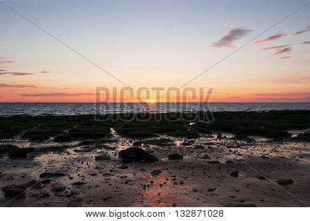 Sunset on Hunstanton Beach in Norfolk, UK.
