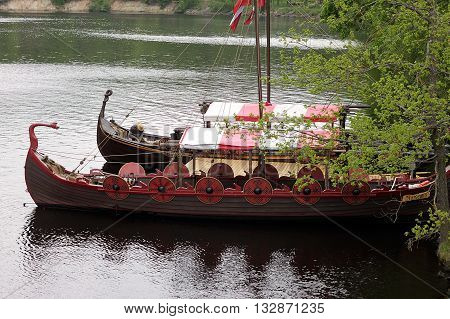 Koknese Latvia - 14 May 2016: The tourist boat in the style of a Viking ship on the river Perse. Perse is a tributary to Daugava River in Latvia.