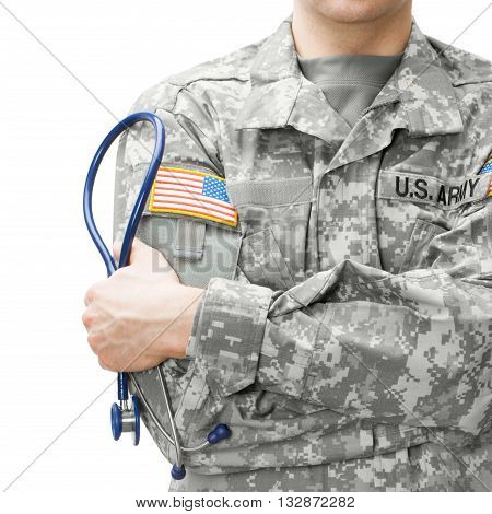 Close up studio shot of US Army doctor holding stethoscope near his shoulder
