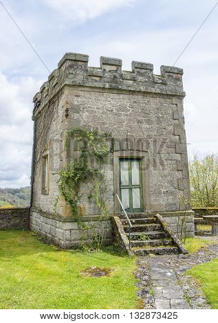 idyllic historic small tower made of stone in sunny ambiance