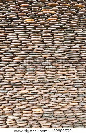 Close up of circle pebble wallabstract background