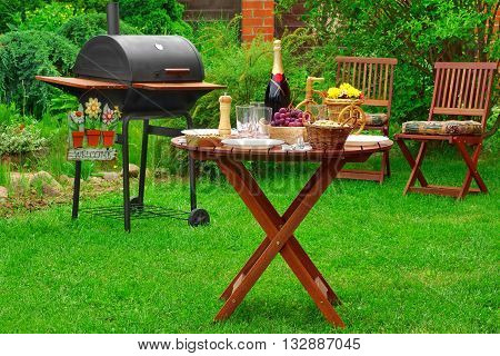 Summer Barbecue Family Party Scene With Grill On   Backyard Garden