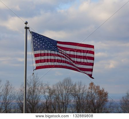 Stars and stripes moving in a breeze in northern Virginia over the Shenandoah Valley