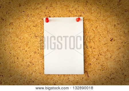 white paper on the brown cork board