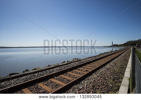 Railway line running along the Firth of Forth at Culross Fife Scotland