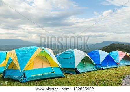 group of tourist tent on the hills with blue sky background