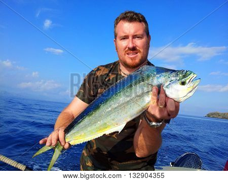 Men holds a fresh catching dolphin fish