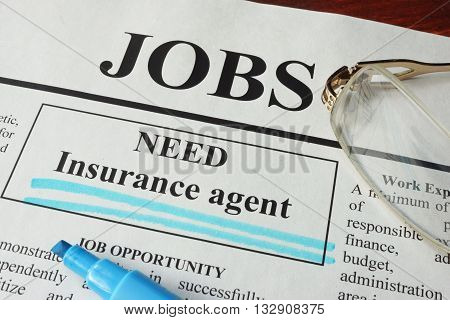 Newspaper with ads for vacancy Insurance agent. Employment concept.