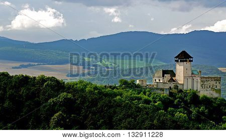 Castle in trencin, slovakia with green countryside