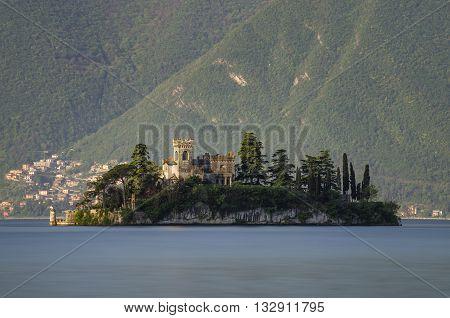 Little island Isola di Loreto on Iseo Lake at sunrise Italy