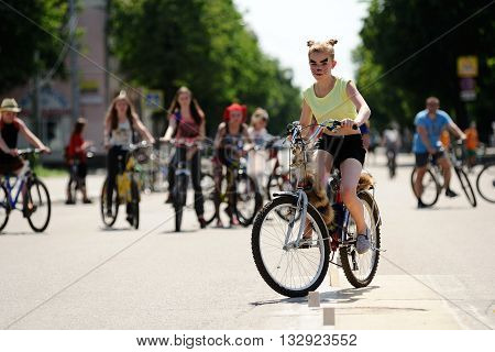 Orel Russia - May 29 2016: Russian Bikeday in Orel. Cat girl overcoming obstacles by bicycle outdoors horizontal