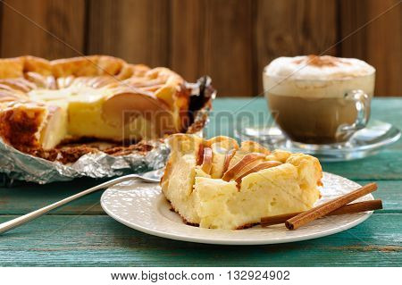Quark pie with apples served with coffee on old wooden table horizontal
