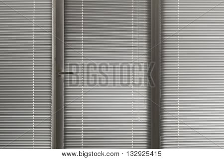 grey horizontal jalousie in the office window