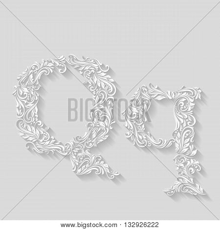 Handsomely decorated letter Q in upper and lower case on gray