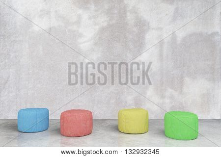 Colorful padded stools in grey concrete room. 3D Rendering