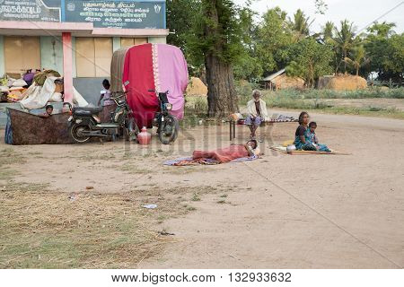 Documetary Editorial. Pondicherry country, India - June 15 2014. Gipsy camp early in the morning. Just get up, working, family closed together, poor workers without house, family way of life