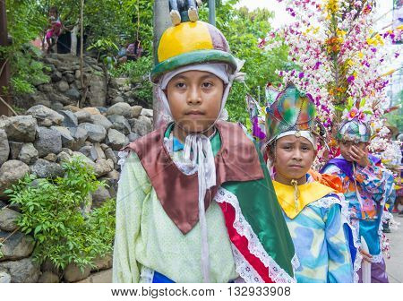 PANCHIMALCO EL SALVADOR - MAY 08 : Salvadorian boys participate in the procession of the Flower & Palm Festival in Panchimalco El Salvador on May 08 2016