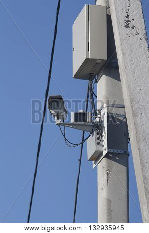 shot of Traffic camera against blue sky