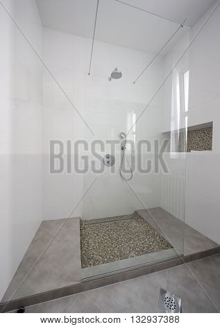modern glass shower cabin in a apartment interior