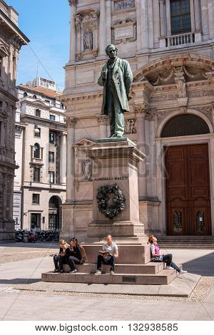 Milan Italy - May 25 2016: Statue of Alessandro Manzoni -1785-1873- Italian poet and novelist in Milan. Sculptor Francesco Barzago.