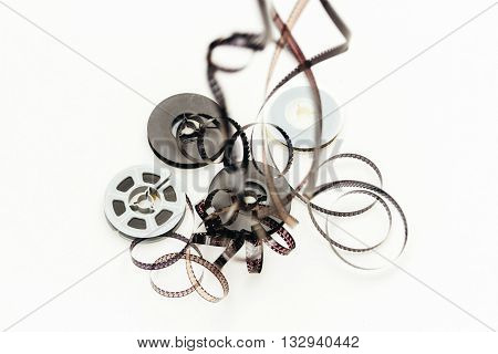 Super 8 film hanging with reels on white background