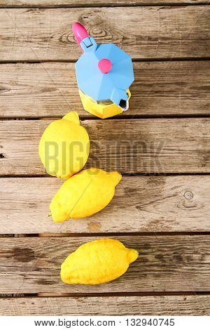 Fresh Lemons On A Wooden Table