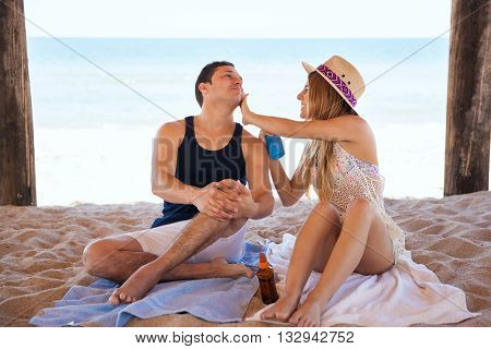 Woman Putting Sunblock To Her Boyfriend