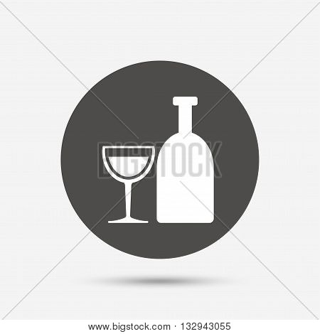 Alcohol sign icon. Drink symbol. Bottle with glass. Gray circle button with icon. Vector