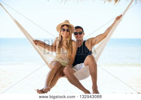 Beautiful Couple Relaxing In A Hammock