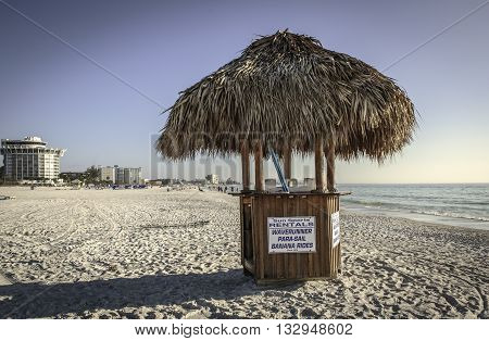 ST. PETE BEACH - MARCH 10, 2016: Beach kiosks are dotted along Florida's gulf coast, catering to tourists who come to enjoy various water sports.